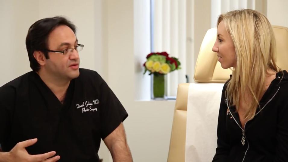 Dr Daniel Golshani with a patient